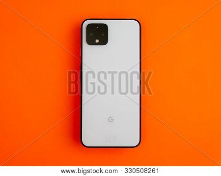 Uk, October 2019: Pixel 4 White Smart Phone On Bright Orange Background