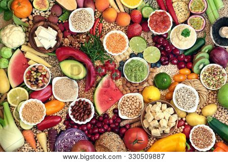 Large vegan health food collection with foods hgh in protein, vitamins, minerals, anthocyanins, antioxidants, fibre, omega 3 and smart carbs. Healthy ethical eating concept. Flat lay.