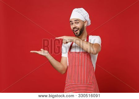Cheerful Young Male Chef Cook Baker Man In Striped Apron White T-shirt Toque Chefs Hat Posing Isolat