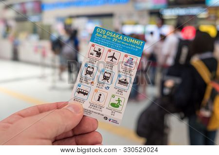 G20 : Man Hand Handling Little Card Given To Every Arriving Traveler From International Flight, In O