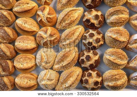 German Bread Rolls Assortment. Diverse Shapes Of Buns. Above View Of Many Types Of Bread Rolls. Buns