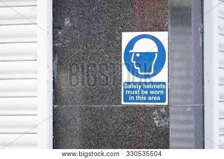 Safety Helmets Must Be Worn Sign On Construction Building Site