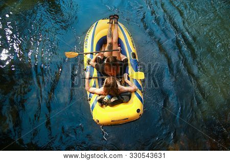 Yosemite Valley, California, Usa - July 10, 2017: Two People Raft Down The Merced River. After Years
