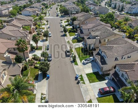 Suburban Neighborhood Street With Big Villas Next To Each Other In Black Mountain, San Diego, Califo