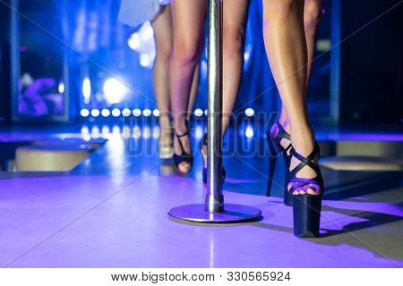 Young Sexy Woman Pole Dancing Striptease With Pylon In Night Club. Beautiful Naked Stripper Girl On