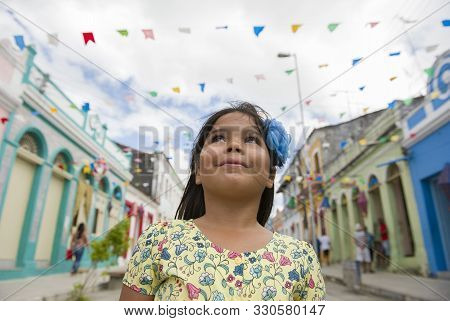 Marechal Deodoro, Alagoas, Brazil - June 21, 2016: Cute Little Brazilian Girl Smiling And Looking Up