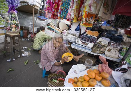 Ho Chi Minh City (saigon), Vietnam - February 17, 2011: Women At Work In Street Market In Saigon Str