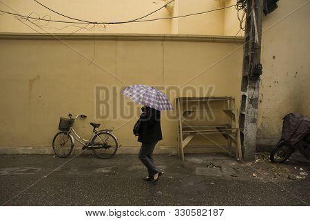 Ho Chi Minh City (saigon), Vietnam - February 17, 2011: Vietnamese Woman Using Umbrella On A Rainy D