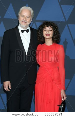 LOS ANGELES - OCT 27:  Tim Robbins, Gratiela Brancusi at the 11th Annual Governors Awards at the Dolby Theater on October 27, 2019 in Los Angeles, CA