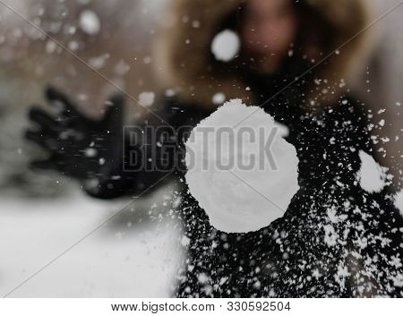 The Girl Throws A Snowball At The Camera. The Snowball Shatters Into Snowflakes.