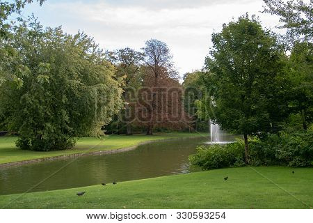 poster of Frederiksberg Gardens (Danish: Frederiksberg Have) is one of the largest and most attractive greenspaces in Copenhagen, Denmark.