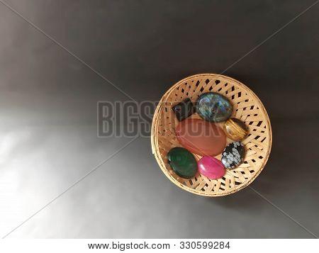 Semiprecious Stones Cabochon In A Cane Bowl. Healing Crystal Stones Malachite Labradorite Snowflake