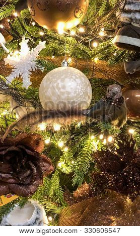 Close Up Of Beautifully Decorated Christmas Ornament Decorations In A Christmas Tree With Golden And