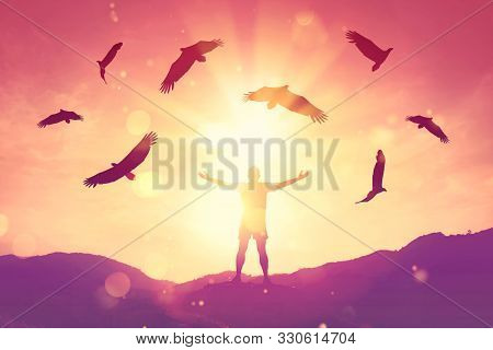 Man Raise Hand Up On Top Of Mountain And Sunset Sky With Eagle Birds Fly Abstract Background. Copy S