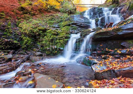 Beautiful Scenery Of Waterfall Shypot. Sunny Autumn Afternoon. Fallen Foliage And Moss On A Massive
