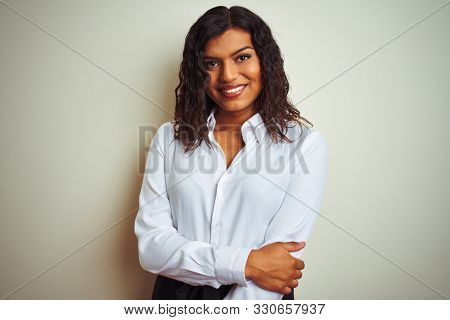 Beautiful transsexual transgender elegant businesswoman over isolated white background happy face smiling with crossed arms looking at the camera. Positive person.