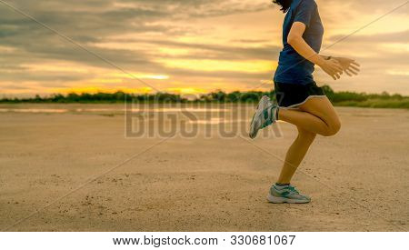 Asian Woman Runner Cardio Exercise In The Morning. Side View Of Woman Legs Jumping. Fit And Strong W