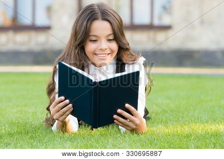 Who Needs Rest When Theres Another Book To Be Read. Adorable Small Child Read Book On Green Grass. C