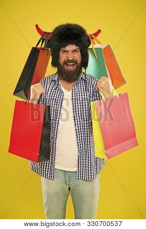 Marvellous Purchase. Bearded Man Smiling With Personal Purchase. Happy Hipster In Bull Horns Hat Hol