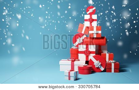 A Stack Of Gift Wrapped Christmas Presents And Snow Fall. 3d Illustration.