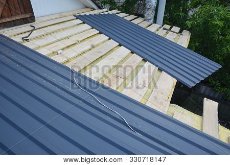Roofing Construction. Installing  Lightweight Metal Roof Tiles Roofing  Construction On House Roofin