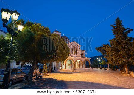 Delphi Greece - July 27 2019; Church Of Saint Nicholas Illuminated By Night Lights