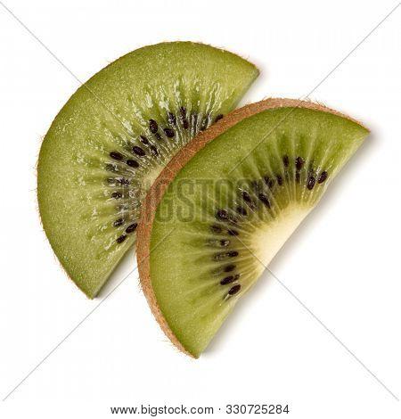 Two kiwi fruit slices isolated over white background closeup. Half of kiwi slice. Kiwifruit slice,  flatlay. Flat lay, top view..