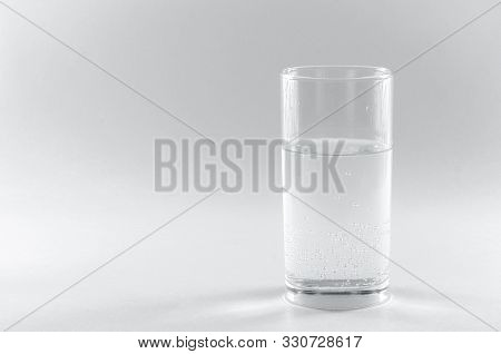 Soda Water In A Glass. Isolated On White Background. A Long Clear Glass Tumbler. Health Concept, The