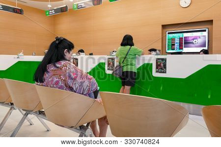 Bangkok, Thailand - October 27: Unnamed Elderly Woman Waits In Que For Teller Service In Kasikorn Ba