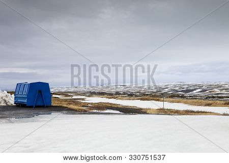 A Dumpster Stands By The Side Of The Road In Iceland