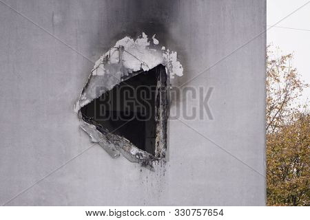 Hole In The Concrete Wall After The Fire, Smoke Soot On The Light Paint, The Need For Repair After T
