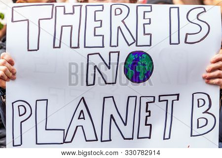 A Home Made Placard Is Viewed Close Up, Reading There Is No Planet B, As Environmentalists Stage A C