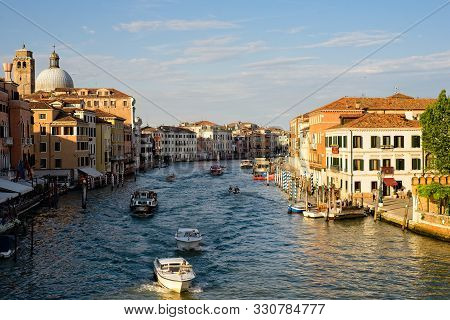 Venice, Italy - June 2, 2019: View Of The Grand Canal From Atop The Ponte Degli Scalzi Bridge Near T