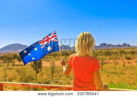 Uluru, Northern Territory, Australia - Aug 25, 2019: Tourism In Northern Territory. Back Of Woman Wi