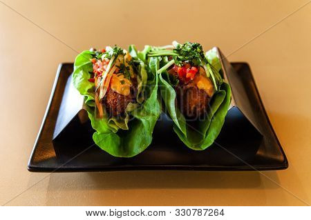A Closeup View Of A Freshly Prepared Appetizer Inside A Trendy Bistro, Two Healthy Lettuce Tacos Stu