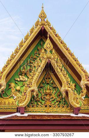 Ko Samui Island, Thailand - March 18, 2019: Wat Laem Suwannaram Chinese Buddhist Temple. Golden Gabl