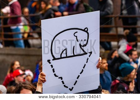 A Close Up View Of A Homemade Poster Held By An Environmentalist, Depicting A Polar Bear Standing On