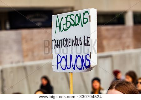 A Homemade French Sign Is Viewed Close Up, Saying Lets Act As Much As We Can, As Climate Change Prot