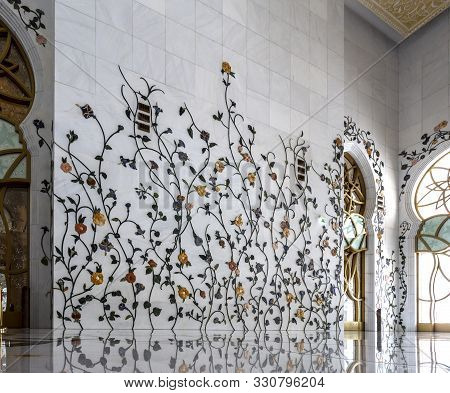 Abu Dhabi, Uae - September 21, 2019: The Interior Walls Decorated With Intricate Floral Inlays Of Th