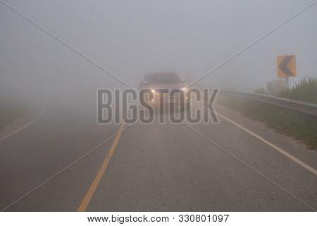 Phu Tub Berk, Phetchabun Thailand 28 Sep 2019 - Toyota Truck Driving In The Fog Mountain With Headli