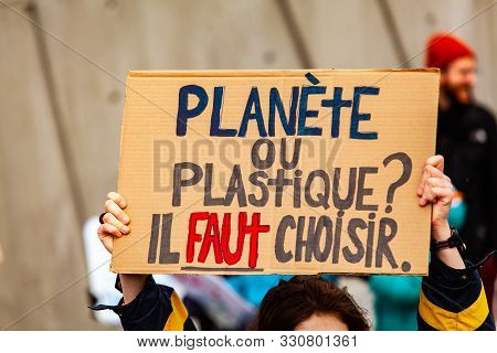 A Close Up View Of A French Sign, Saying Plastic Or Planet, You Have To Choose As Environmental Prot