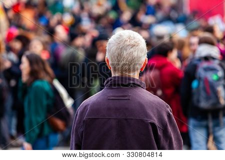 An Older Man Is Viewed From The Rear With Grey Hair, Contemplating A Crowd Of Environmentalists Marc