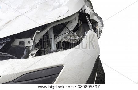 Close Up Head Light Of  White Color Car Have Damaged And Broken By Accident Isolated On White Backgr