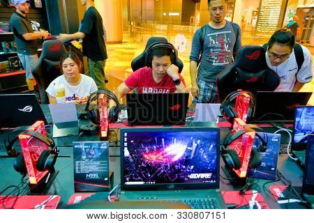 SHENZHEN, CHINA - CIRCA APRIL, 2019: a man using a laptop at Asus ROG Store in Shenzhen. Republic of Gamers is a brand used by Asus.