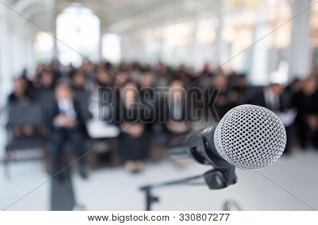 Microphones On The Funeral Podium And People Wearing Black In The Church