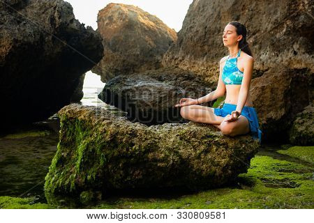 Yoga Lifestyle. Young Woman Meditating, Practicing Yoga And Pranayama At The Beach. Hands In Gyan Mu
