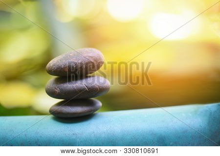 Natural Wellness Concept / Relax Zen Stones Stack On Wooden Nature Green Background Spa Natural Alte
