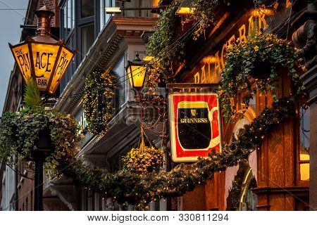 Dublin, Ireland, December 24, 2018: Close Up Of The Exterior Of The Palace Bar, Decorated For Christ
