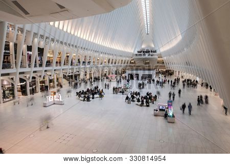MANHATTAN, USA-OCTOBER 9, 2019: Commuters and mall goers move through the building known as the Oculus Hub in downtown Manhattan, New York City, USA.