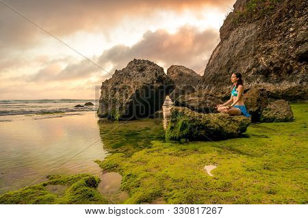 Scenic Landscape. Woman Meditating, Practicing Yoga And Pranayama. Gyan Mudra. Lotus Pose. Tranquil